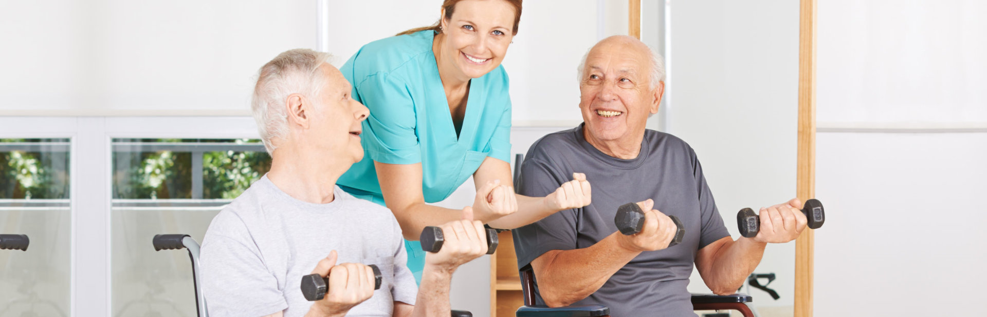 caregiver assisting old men exercising